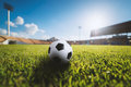 Soccer ball on the grass in soccer stadium Royalty Free Stock Photo
