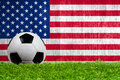 Soccer Ball On Grass With US F...