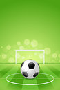Soccer ball on green background with grass and gridiron Stock Photo