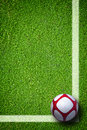 Soccer ball on green grass closeup image of football Royalty Free Stock Photo