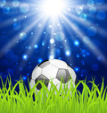 Soccer ball on green grass with shine effect illustration Royalty Free Stock Photo