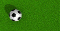 Soccer ball on green grass top view Royalty Free Stock Images