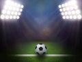 Soccer ball on green stadium Royalty Free Stock Photo
