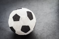 Soccer ball made ​​of fabric on a dark background with space for text etc Royalty Free Stock Photos
