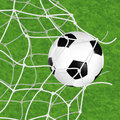 Soccer ball in net concept goal torn on textured grass background vector illustration Stock Images