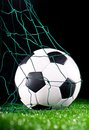 Soccer ball in the net gate Stock Photos