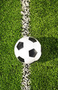 Soccer ball new and clean on field selective focus Royalty Free Stock Images