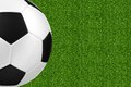 Soccer ball over green grass Royalty Free Stock Photo