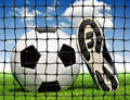 Soccer ball and shoes Royalty Free Stock Image