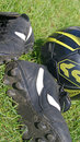 Soccer ball and shoes on grass Royalty Free Stock Image