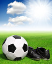 Soccer ball and shoes in grass Royalty Free Stock Photos