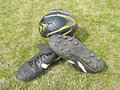 Soccer ball and shoes on a green lawn Royalty Free Stock Photos