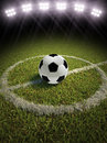 Soccer ball on a soccer field d rendering of with lights Stock Photo