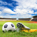 Soccer ball and soccer shoes on the field Stock Image