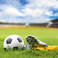 Soccer ball and soccer shoes on the field Stock Images
