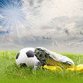 Soccer ball and soccer shoes on the field Stock Photography