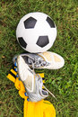 Soccer ball and soccer shoes on the field Stock Photo