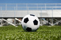 Soccer ball with stands in background Royalty Free Stock Photo