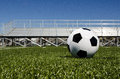 Soccer ball with stands image of in background Stock Image