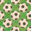 Soccer balls on grass, seamless Stock Images