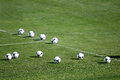 Soccer balls in grass stadium Royalty Free Stock Photo