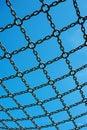 Soccer cage goal, blue sky, net grid imprisoned