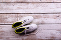 Soccer cleats against wooden background. Studio shot. Copy space Royalty Free Stock Photo