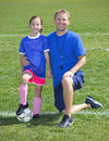 Soccer coach and soccer player portrait a of a posing with his young daughter Stock Images