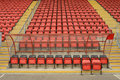 Soccer dugout and seats closeup of or football with red in background Royalty Free Stock Photo
