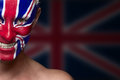Soccer fan with great britain flag painted over face Stock Photography