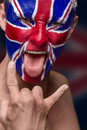 Soccer fan with great britain flag painted over face Stock Photo