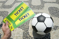 Soccer fan holds tickets above football in brazil hand two handmade ball rio de janeiro Royalty Free Stock Photos