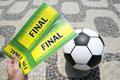 Soccer fan holds tickets to football world cup final in brazil two the match above ball rio de janeiro Stock Photography