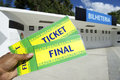 Soccer fan holds two brazil tickets at the stadium outside ticket window Royalty Free Stock Photo