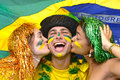 Soccer fans kissing each other group of happy brazilian celebrating victory Royalty Free Stock Photo