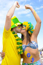 Soccer fans kissing each other happy couple of brazilian commemorating victory Royalty Free Stock Image