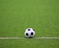 Soccer field with ball white stripe on the green Royalty Free Stock Photo