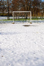 Soccer field covered with snow Stock Photos