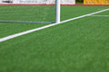 Soccer field with goal post selective focus of Stock Photography
