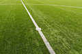 Soccer field lines on green grass Stock Photography