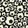 Soccer and football balls dark seamless vector pattern eps10 Royalty Free Stock Photo