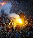 Soccer or football fans using pyrotechnics serbia belgrade april celebrating goal during serbian championship game between Royalty Free Stock Photos