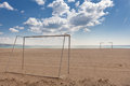 Soccer football goals on the beach beach soccer football cloudy sky Stock Photo