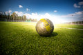 Soccer football on grass field at sun beams Royalty Free Stock Photo