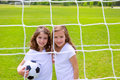 Soccer football kid girls playing on field sports outdoor Royalty Free Stock Image