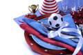 Soccer football party table in red white and blue team colors celebration setting with pates cutlery glasses trophy ball Royalty Free Stock Images