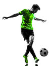 Soccer football player young man dribbling silhouette one in studio on white background Royalty Free Stock Photography