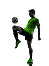 Soccer football player young man juggling silhouet one in silhouette studio on white background Stock Images