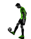 Soccer football player young man juggling silhouette one in studio on white background Stock Image