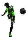 Soccer football player young man kicking silhouett one in silhouette studio on white background Royalty Free Stock Image